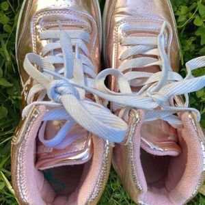 Stylish shiny pink shoes that roll